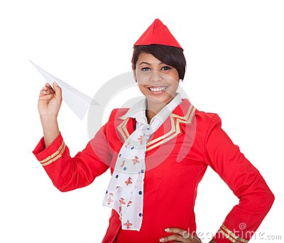 Smiling beautiful stewardess launching a place