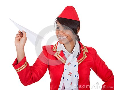 Smiling beautiful stewardess launching a place