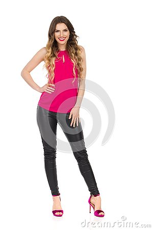 Free Smiling Beautiful Woman In Pink Top, Leather Trousers And High Heels Royalty Free Stock Image - 133773566