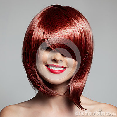 smiling beautiful woman with red short hair haircut