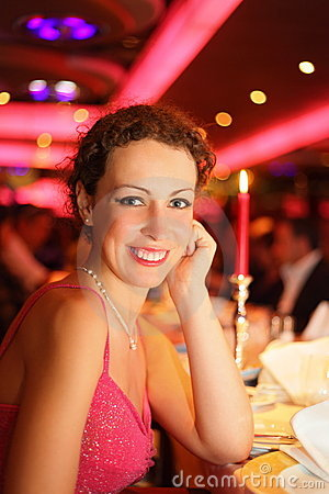 Smiling beautiful woman wearing evening dress