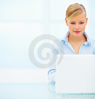 Smiling beautiful young business woman working on
