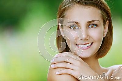 Smiling beautiful young woman close