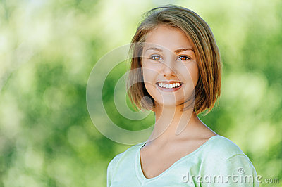 Smiling beautiful young woman close