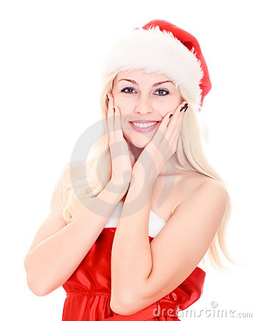 Smiling beautiful young woman wearing santa hat.