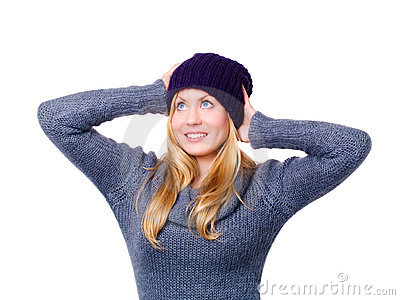 Smiling beautiful young woman in winter clothes