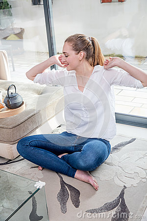 Free Smiling Beautiful Young Woman With Crossed Legs Stretching Her Arms Royalty Free Stock Image - 91454126