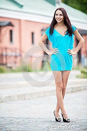 Smiling beauty in blue dress