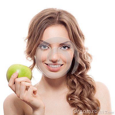 Smiling beauty holding green apple while isolated