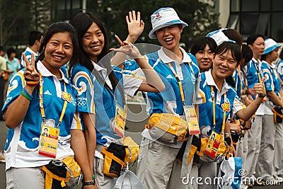 Smiling Beijing Olympic Student Volunteers wave Editorial Image