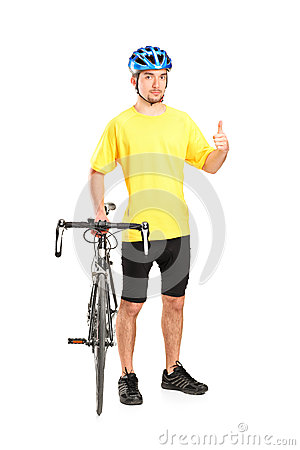 Smiling bicyclist posing and giving thumb up