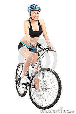 Smiling biker sitting on a bike