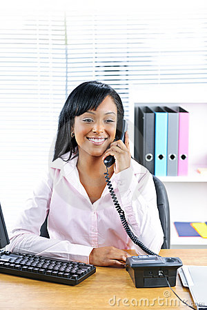 Free Smiling Black Businesswoman On Phone At Desk Royalty Free Stock Photos - 17802728