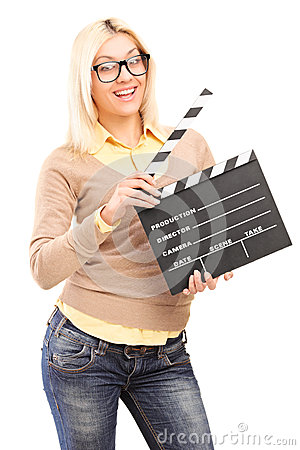 A smiling blond female holding a movie clap