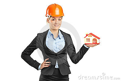 Smiling blond forewoman holding a model house