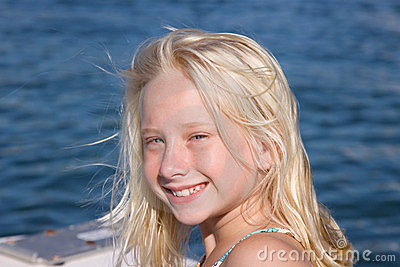Smiling Blond Girl on Boat