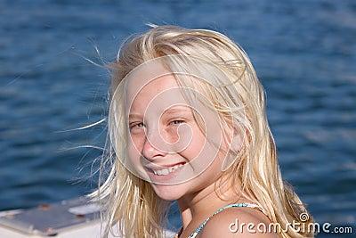 Smiling Blond Girl on Boat