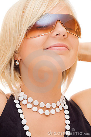 Smiling blond girl in sun glasses
