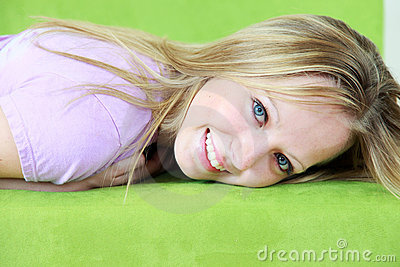 Smiling blond haired teenager