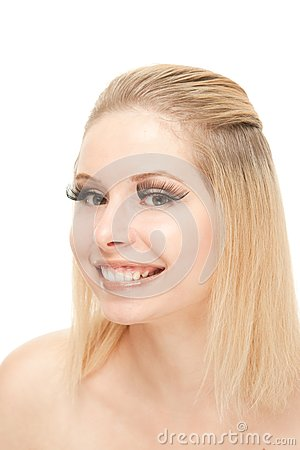 Smiling blond with lengthen eyelashes