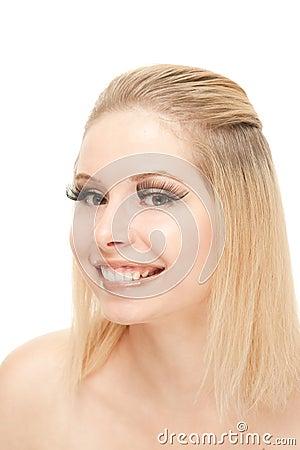 Smiling blond with lengthen eyelashes