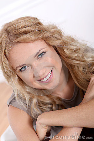 Smiling blond woman with blue eyes