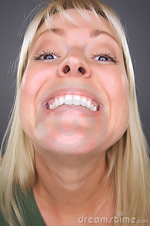 Smiling Blond Woman with Funny Face
