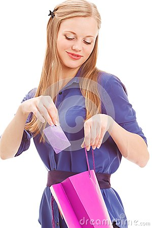 Blond woman put in card into bag