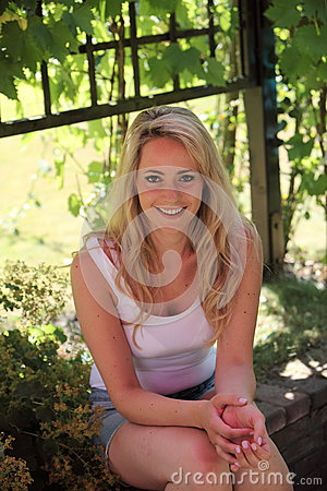 Smiling blond woman relaxing in the shade