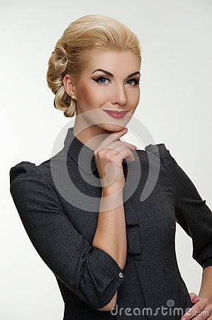 Smiling blond woman with a retro make-up