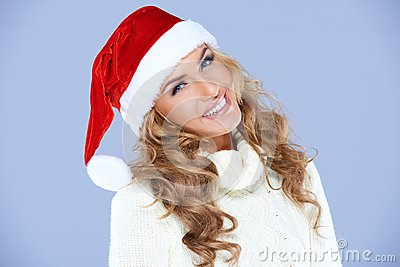Smiling blond woman in Santa hat isolated