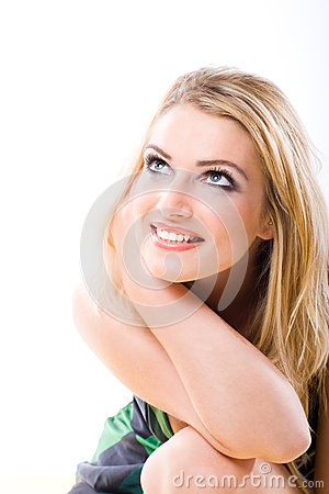 Free Smiling Blond Woman Staring Thoughtfully Upwards Royalty Free Stock Photos - 35322658