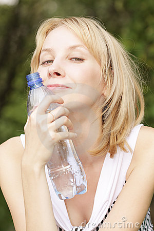 Smiling blonde with bottle of water