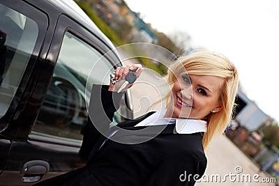 Smiling blonde with car keys
