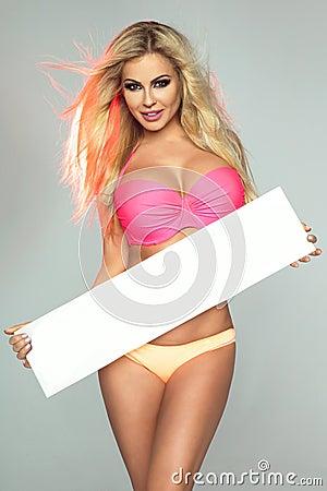 Free Smiling Blonde Girl In Bikini. Royalty Free Stock Photos - 71919858