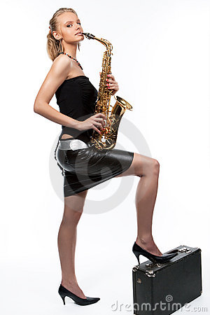 Smiling blonde girl with saxophone and suitcase