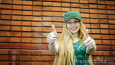 Smiling blonde showing thumbs up