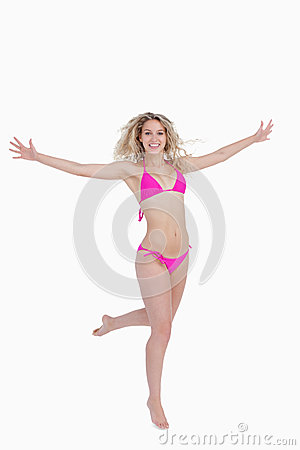 Smiling blonde woman opening her arms