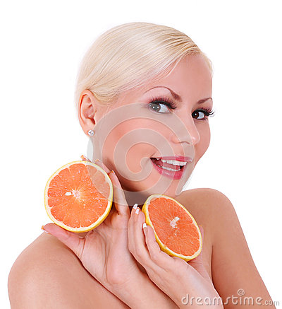 Smiling blonde young woman with orange fruits isolated