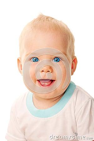 Smiling blue-eyed baby face close-up.