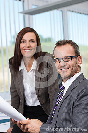 Smiling boss with his secretary