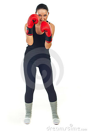 Smiling boxer woman defending