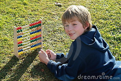 Smiling boy with an abacus