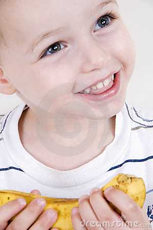 Smiling boy with banana