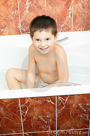 Smiling boy in bath