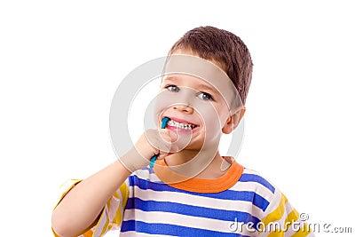 Smiling boy brushing teeth