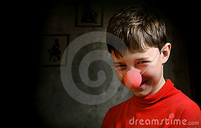 Smiling boy in dark room