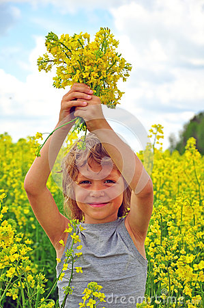 Smiling boy with flowers