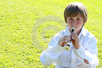 Smiling boy with a flute