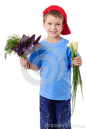 Smiling boy with greens